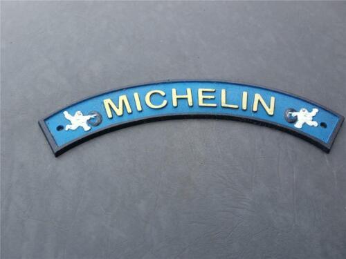 Michelin Tires with Bibendum Figurines Vintage Bowed Cast Iron Sign