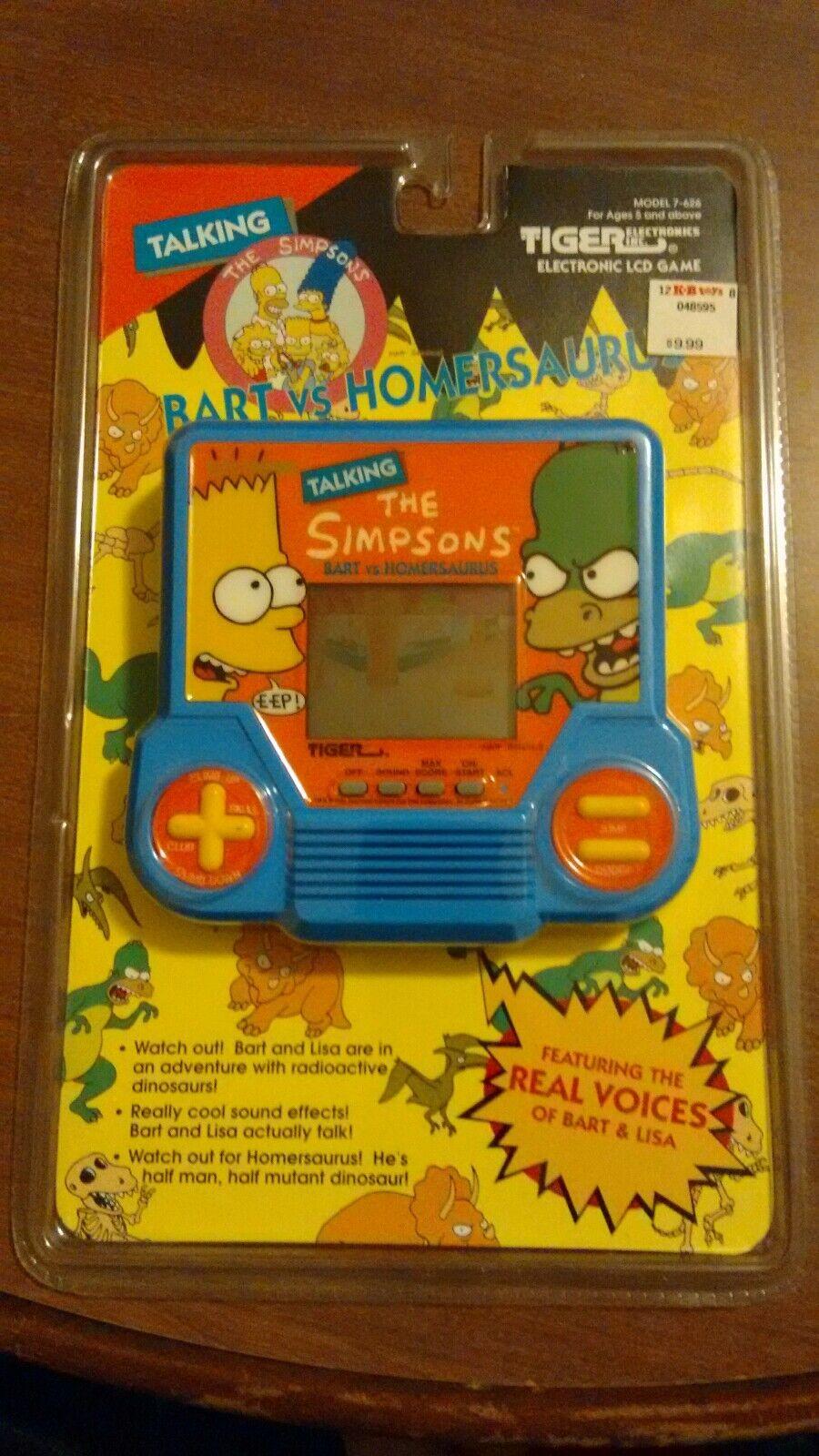 Simpsons - Bkonst mot Hemrsaurus Tiger som pratar elektroniskt spel LCD -årgång.