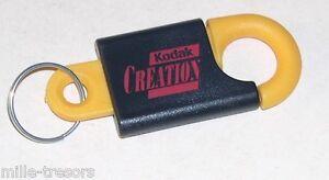 Porte-clefs-KODAK-Du-type-mousqueton-KODAK-Creation-Modele-JAUNE