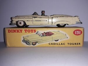 Coffret Dinky Toys 131 Corps jaune Cadillac Tourer, intérieur rouge, moyeux crème