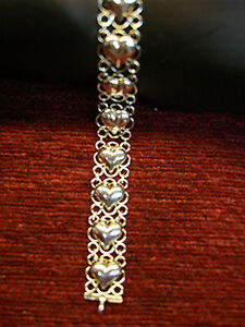 DARLING-STERLING-HEART-BRACELET-WITH-14-HEARTS-NICELY-DESIGNED-MUST-SEE