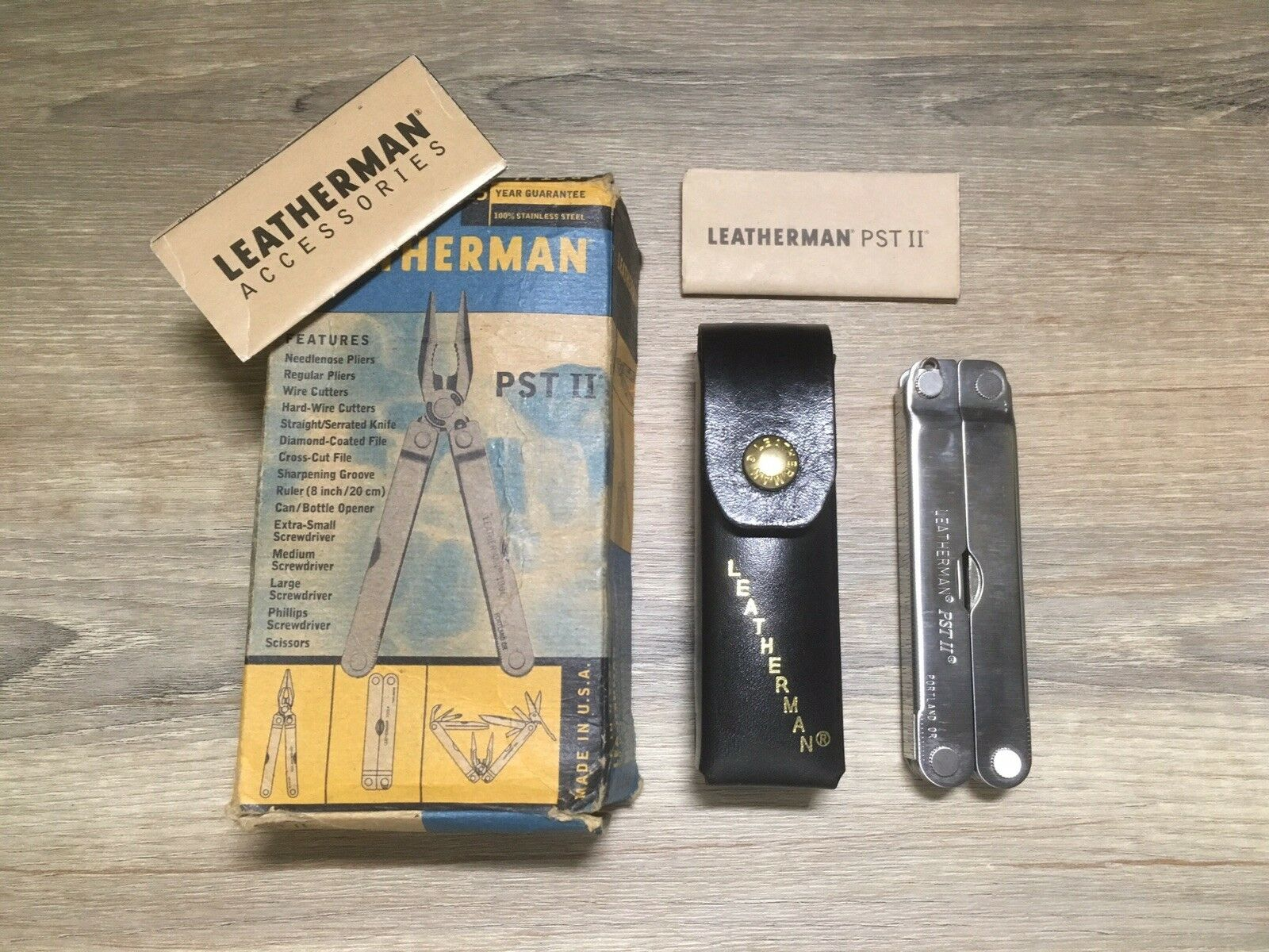 New  Leatherman PST II With the  inscription USA, Original Leather Case and Box.  amazing colorways