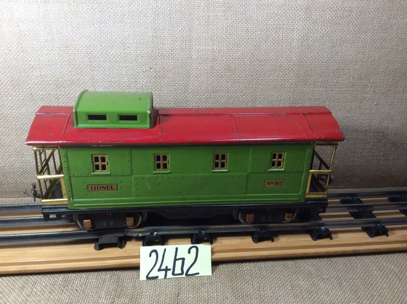 Lionel Standatd gauge caboose with red roof, lighted.