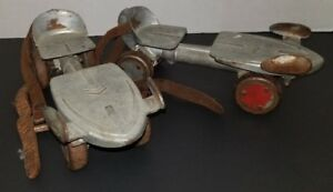 Antique-JC-Higgins-Sears-Roebuck-and-co-metal-slip-on-roller-skates