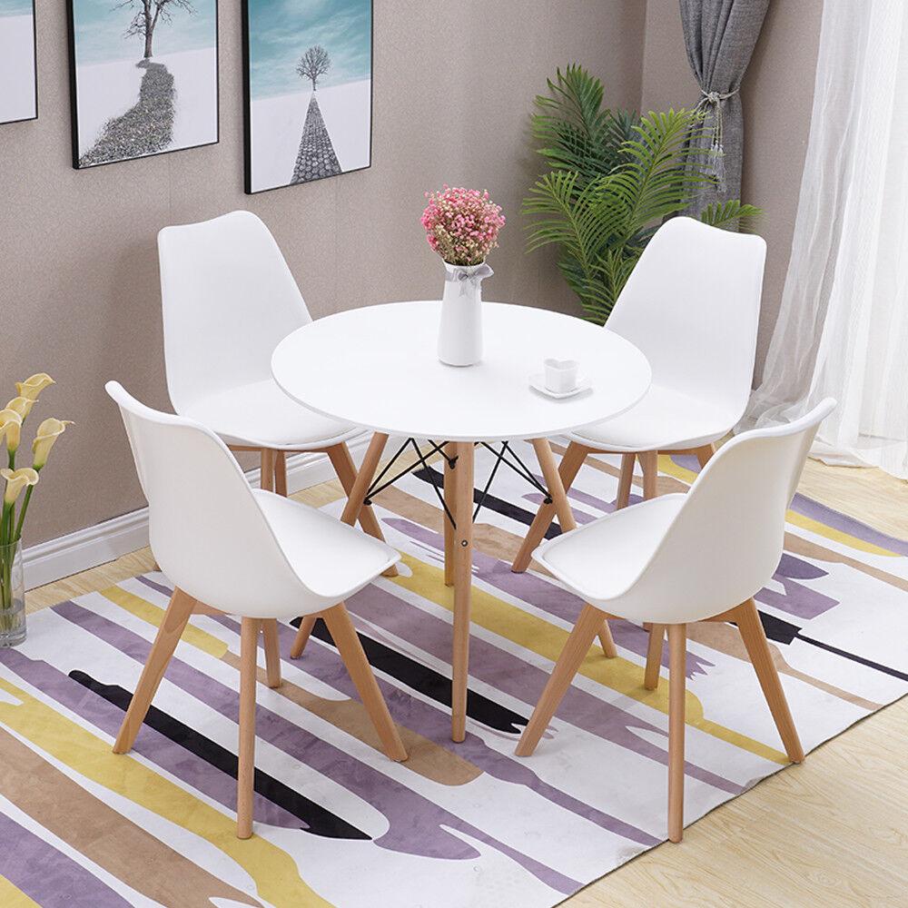 runder esstisch mit stühlen