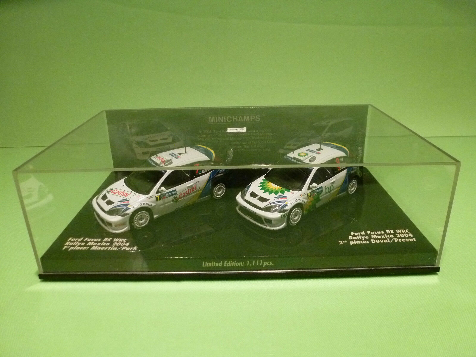 MINICHAMPS FORD FOCUS RS WRC - 1st+2nd MEXICO 2004 No 7 + 8 - WHITE 1 43 - NMIB