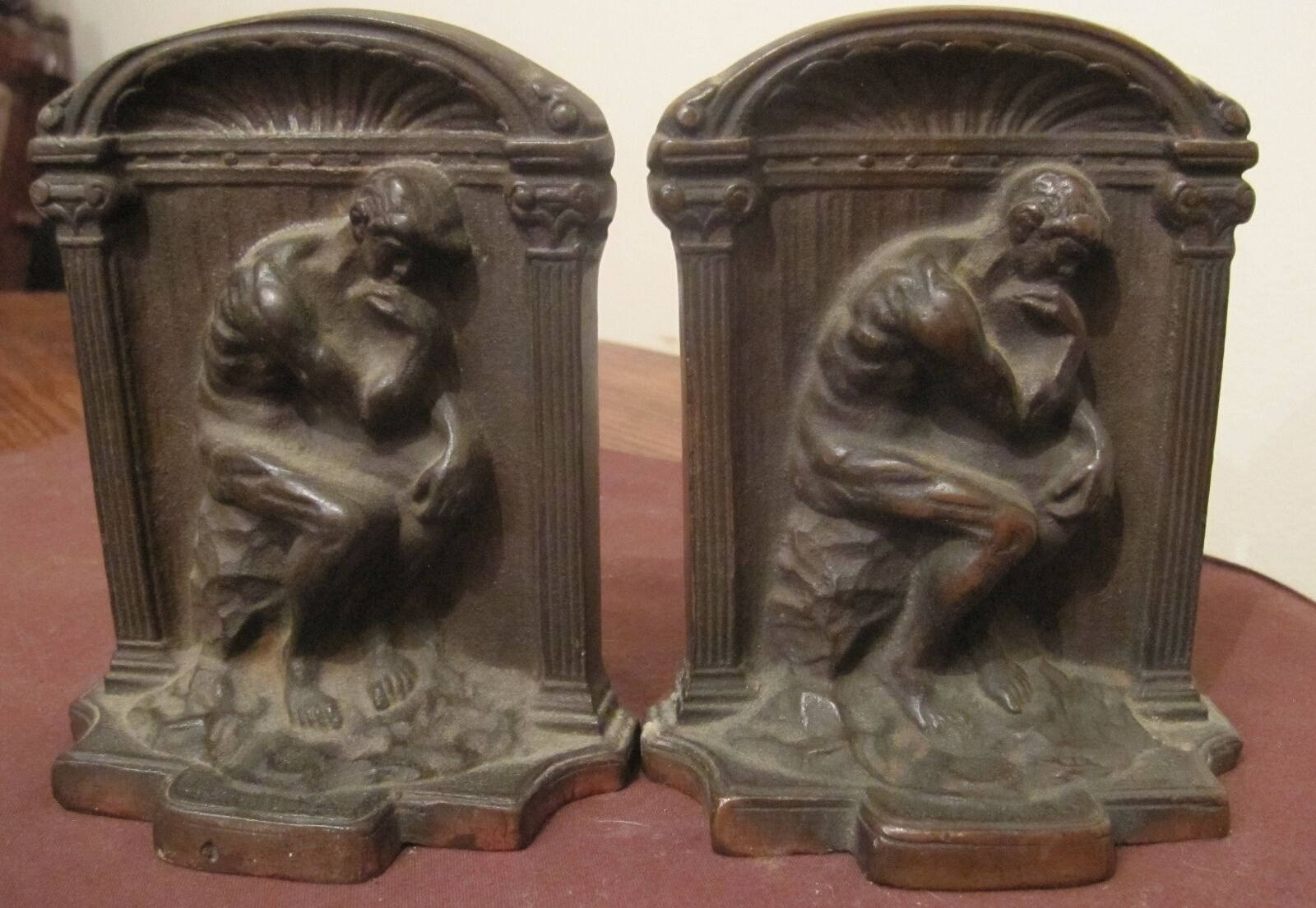 Pair of 2 antique solid heavy figural bronzed cast iron thinking man book ends