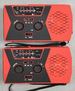 Lot of 2 Emergency Solar Hand Crank Weather Radio Power Bank Charger FlashLight