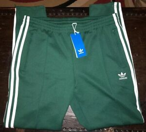 adidas sst track pants womens green