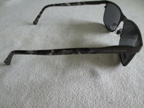 Moy New with case. Land Rover gunmetal frame polarized sunglasses