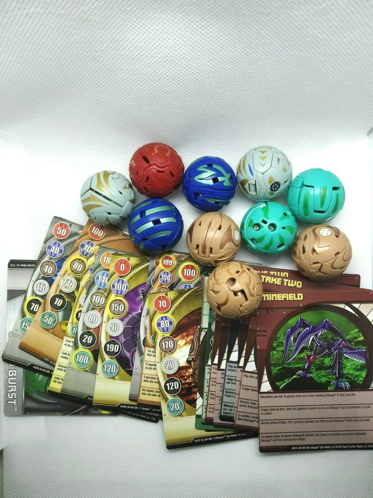 BAKUGAN BATTLE BRAWLERS LOT OF10 BAKUGAN WITH 12 METAL CARDS AND 9 OTHER CARDS