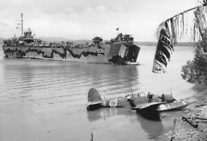 WWII-photo-downed-Japanese-seaplane-and-American-amphibious-assault-ship-LST-57k