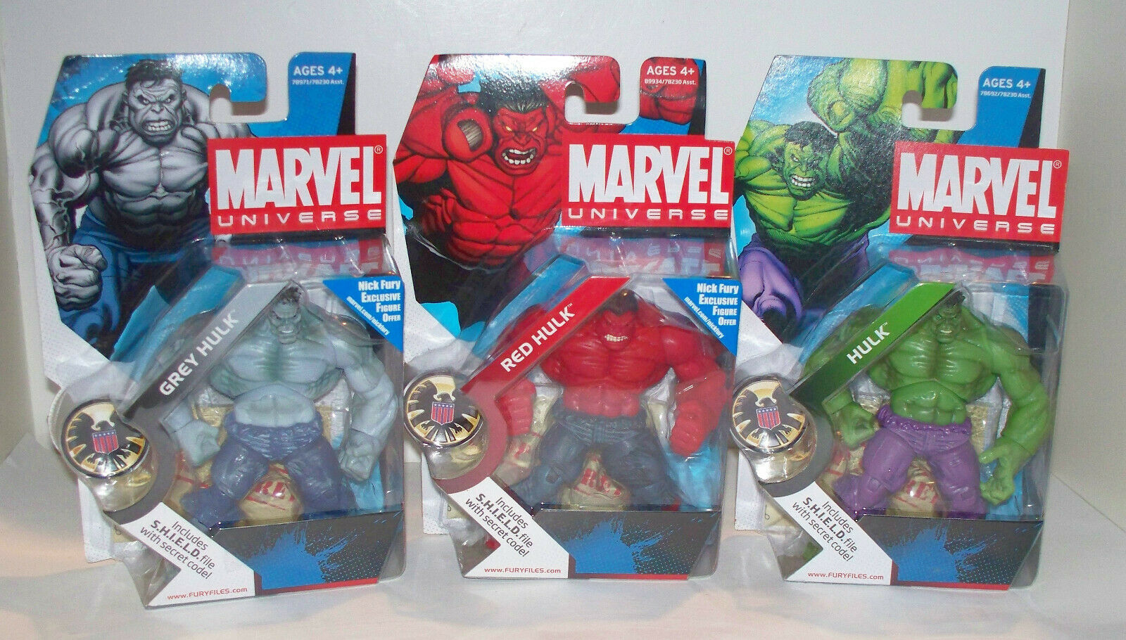 Marvel universe - set of three - grey hulk red hulk green hulk - unopened.