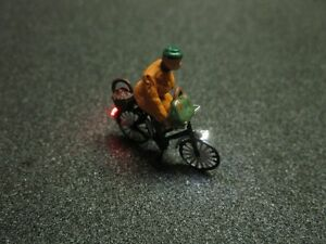 F61 - H0 Bicycle with ledlighting with Figure Old Woman 1:87