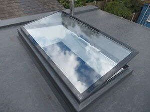 Flat roof skylight hinged remote controlled electronic for Skylight with remote control