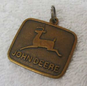 2 New John Deere Key Chains Gold Key Chain w// bag /& John Deere 9020 4WD Tractor.
