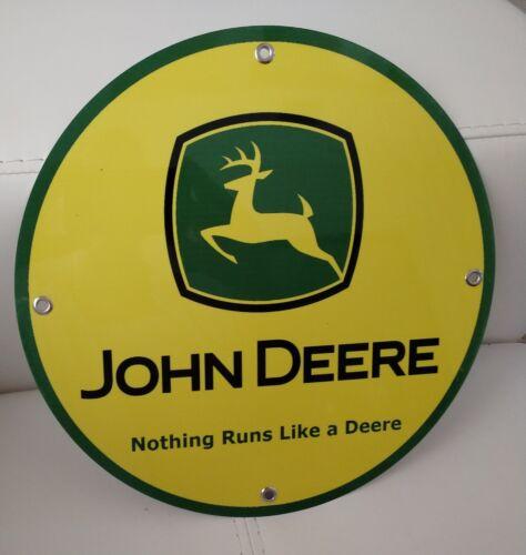 John Deere advertising sign...~12 inch diameter