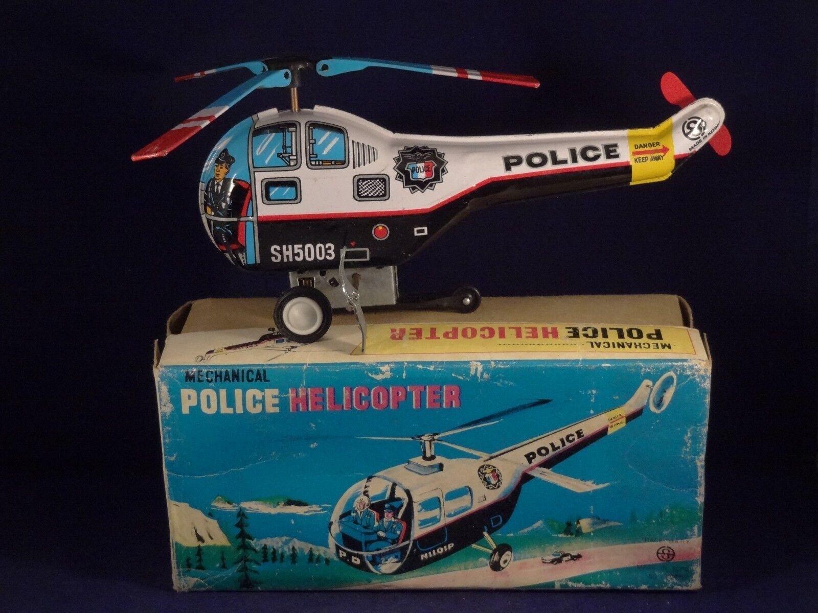 Ancien jouet tôle hélicoptère police mécanique SH 5003 en  boîte d'origine  Commandez maintenant