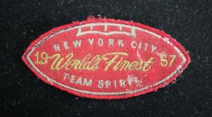 """VINTAGE 1957 NEW YORK WORLD'S FINEST RED AND GOLD PATCH 4 1/2"""" X 2"""""""