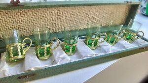Vintage Made in Japan Green Shot Glasses with Gold Holder in a box 1950's?