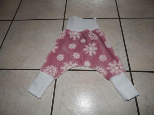 Mitwachshose-Pump Pantaloni da plüschfleece rosa con fiocchi di neve