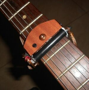 """Rolling Guitar Capo, """"Fastest in the World"""" - brown, real wood veneer"""