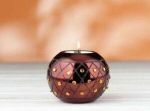 Teelichthalter-aus-bronzefarbenem-Glas-in-Kugelform-mit-gelben-Steinen-besetzt