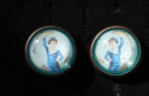 28-50 - Pair vintage bridle rosettes Lady or child with big fish