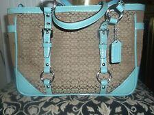 Coach turquoise and brown designer handbag