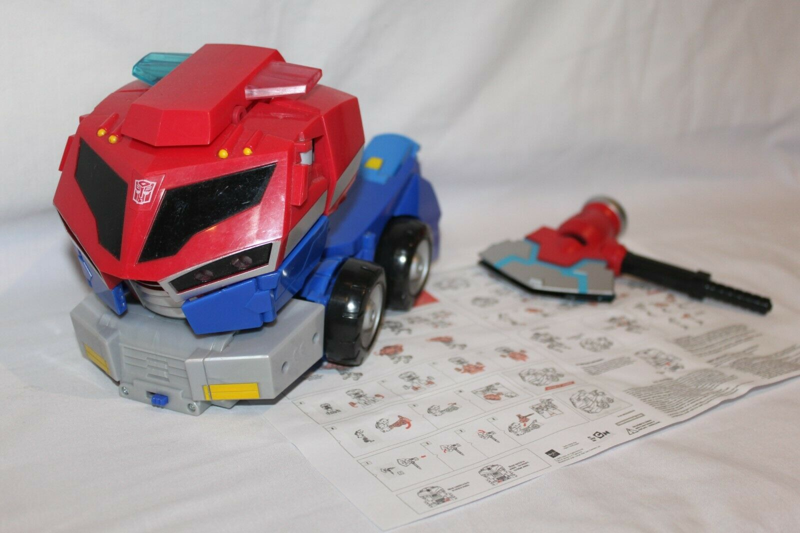 Animated Transformers Roll Out Command Optimus Prime with weapon some damage