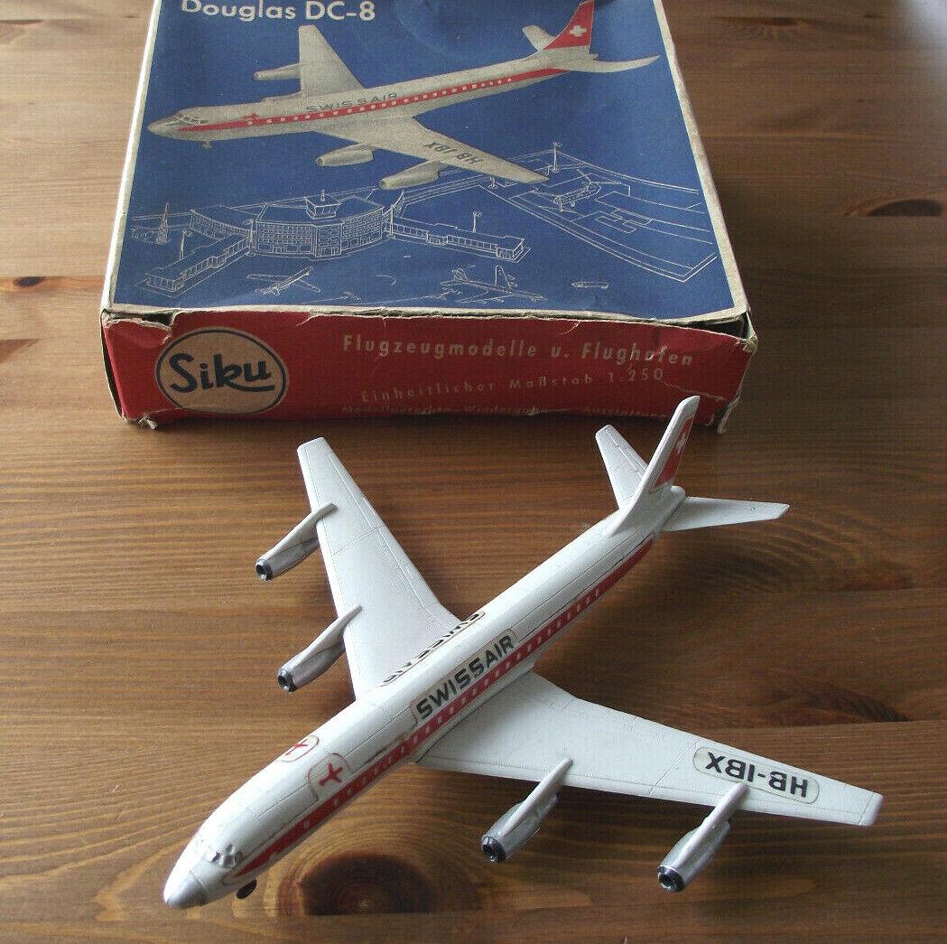 Siku PLASTICA 1:250: Douglas dc-8 (Swissair) con imballo originale.