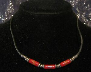 Bootlace-style-necklace-with-silver-tone-metal-fittings-amp-long-red-beads