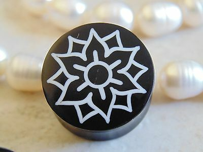 Organic Horn Saddle Fit Plug with White Lotus Inlay.