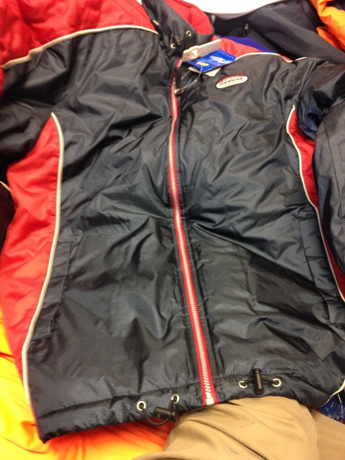 REEBOK COATS ATHELECTIC DEPARTMENT IN 36 38 OR 40 INCH LONG COAT AT  NAVY RED