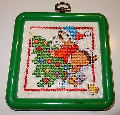Finished Cross Stitch Christmas ornament of Raccoon decorating the tree