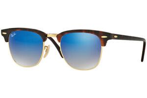 Gafas-de-sol-Ray-Ban-Rb-3016-en-990-7Q-Habana-con-lentes-azules-y-el-caso-y-pano