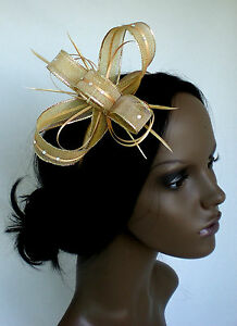 Shimmering-gold-fascinator-with-sparkling-diamante-on-comb-Alice-band-or-clip