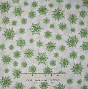 Christmas-Fabric-Holiday-Magic-Green-Snowflake-Toss-on-White-Windham-YARD