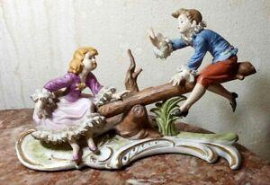 "Antique Poly-chrome Porcelain Bisque Lace Figurine, Seesaw. 7.5"" H x 11"""
