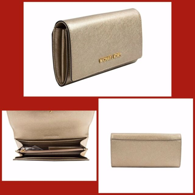 1e6f51fc005d95 Michael Kors Jet Set Travel Pale Gold Leather Carryall Wallet 35H6MYAE7M