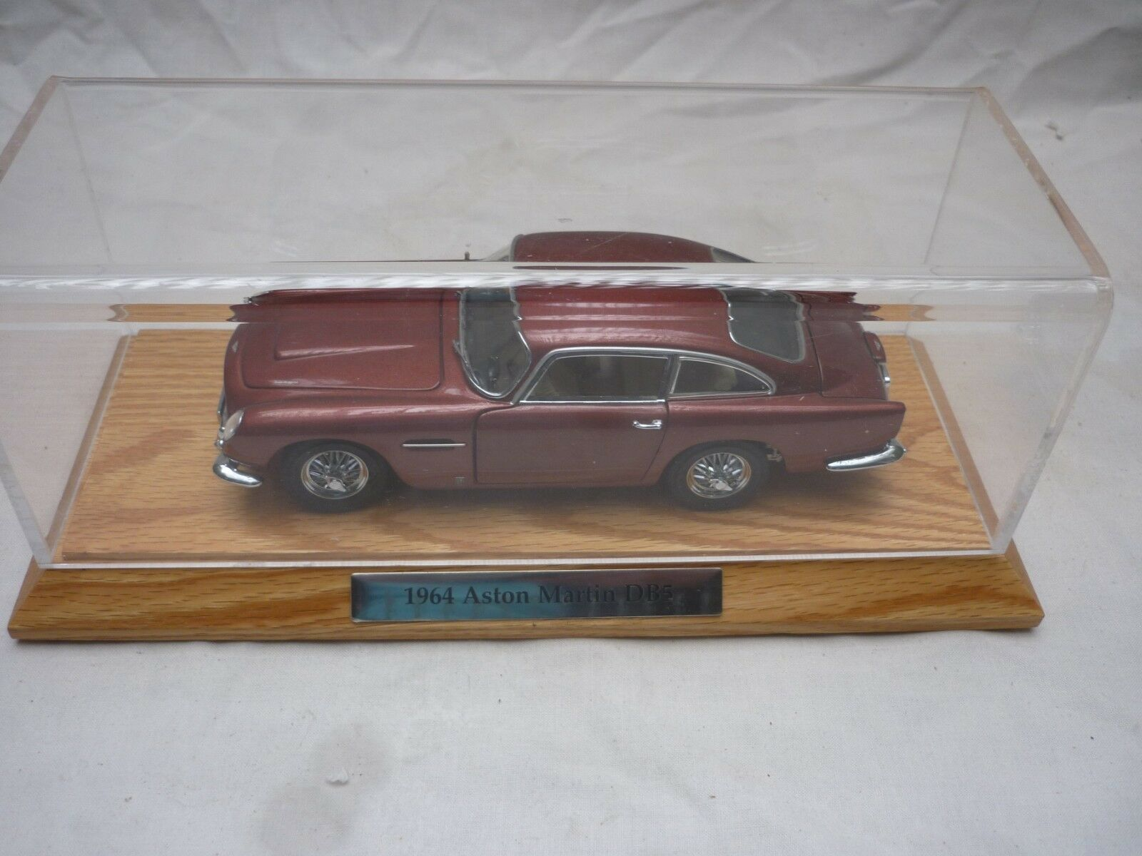 A Danbury mint model of  a 1964 Aston Martin DB5. no box  has a display case