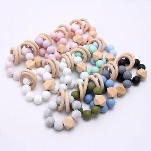 Baby-nome-di-perline-in-silicone-Teether-Braccialetto-Anello-di-dentizione-in-Legno-Sonagli-Toys
