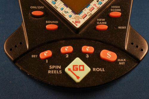 MONOPOLY JACKPOT SLOT MACHINE ELECTRONIC HANDHELD VIDEO LCD GAME CASINO VEGAS