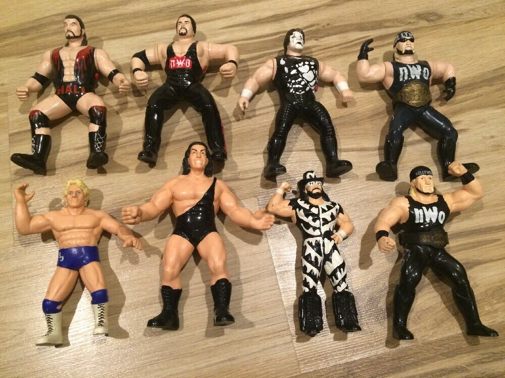 8 Lot WCW Wrestling Action Figures NWO Hogan Sting Macho Flair Giant Nash Hall