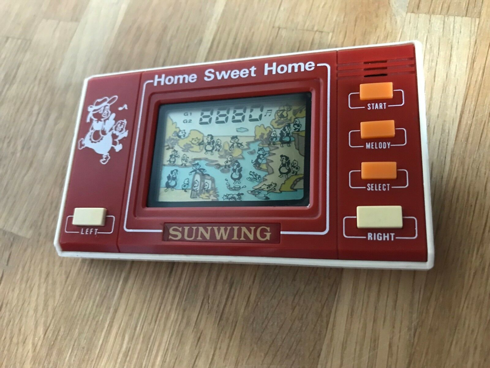 Rare Sunwing Home Sweet Home 1980's Vintage LCD Handheld Electronic Game in VGC.
