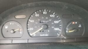 1995 GEO Metro 4dr sedan.