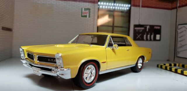 WELLY 1965 Pontiac GTO Yellow Die Cast Model Car American Muscle 1 26 for sale online