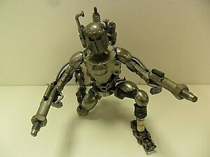 Metal-Kneeling-Boba-Fett-Sculpture-Made-From-Recycled-Metal