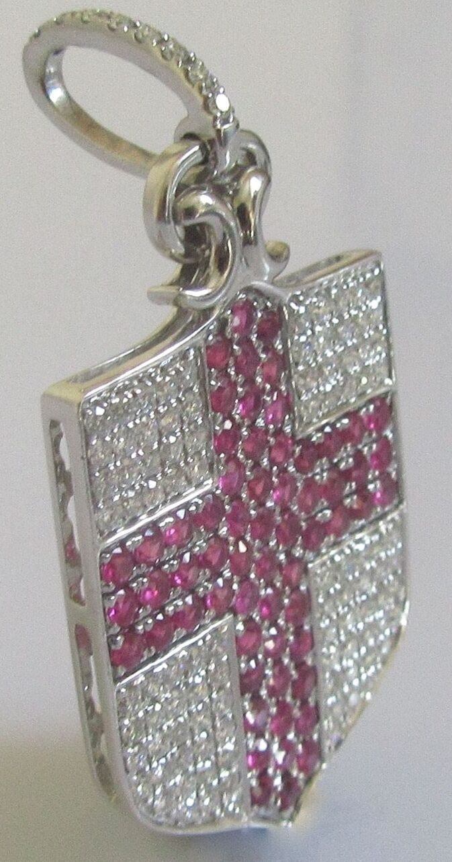 Secondhand 18ct white gold multi diamond multi ruby shield pendant.