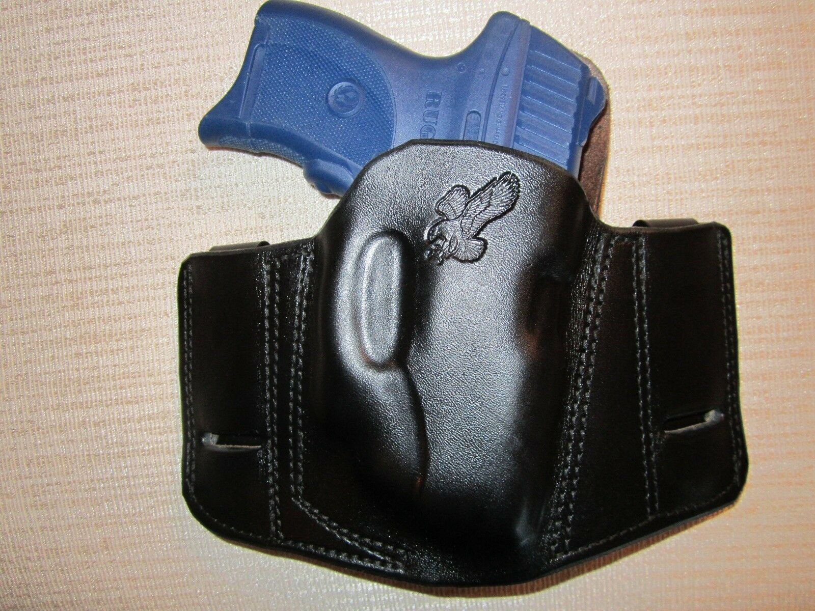 RUGER LC9 WITH CRIMSONTRACE LASER  REVERSIBLE, IWB OR OWB, R H,PANCAKE HOLSTER
